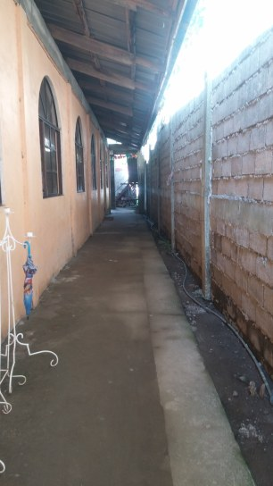 This is a covered hallway. The building to the left is the sanctuary. Wall to the right. It leads to the kitchen area, back yard, and boarding rooms